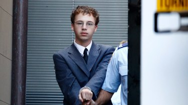 Jack Kelsall being led to a prison van on March 16, 2015, during his trial for Morgan Huxley's murder at the NSW Supreme court.