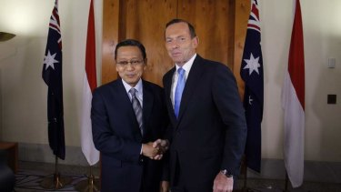 Prime Minister Tony Abbott greets Indonesian Vice President Dr Boediono. Mr Abbott kept senior Indonesian officials waiting to stay in Parliament for a debate about name-calling.
