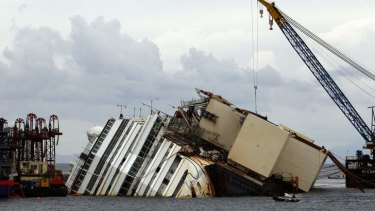 The Costa Concordia ship lies on its side on the Tuscan Island of Giglio, Italy. Authorities have given the final go-ahead to pull upright the crippled cruise liner from its side in the waters off Tuscany.
