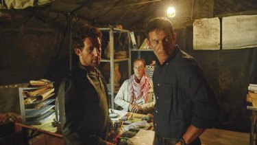 Jason Issacs (right) as FBI agent Peter Connelly in <i>Dig</i>.