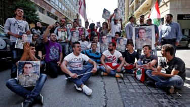Kidnappings continue: Families of missing Lebanese who were kidnapped by Islamic State militants and the Al-Nusra Front protest for their release in Beirut, Lebanon.
