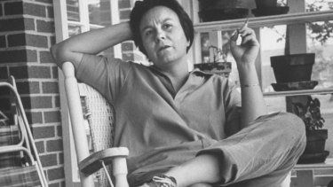 Harper Lee takes time out while visiting her home town,  Monroeville, Alabama, in 1961.