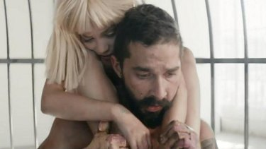 Still from Sia's <i>Elastic Heart</i> video clip, featuring Maddie Ziegler and Shia LeBeouf