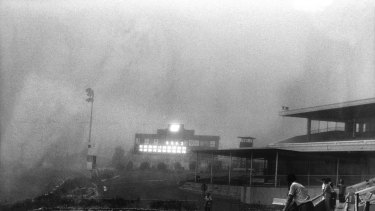 The dust storm hits Moonee Valley Racecourse. The races continued, but few punters remained.