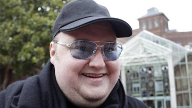 Kim Dotcom leaves the High Court in Auckland.