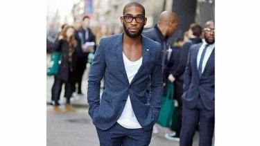 Rapper Tinie Tempah adds casual cool by wearing a basic t-shirt under a suit jacket.