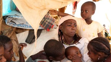 Displaced hope … Malian refugee Saouda Baye mourns the death of her two-year-old son, Moussa, while another is being treated for malnutrition at a camp in Mangaize, in neighbouring Niger.