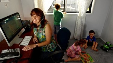 House calls: AAMI staff member Shermaine Fitzgerald in her home office with her children.