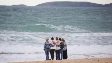 The family of Zac Young visit the beach where he died after a shark attacked him on Saturday.