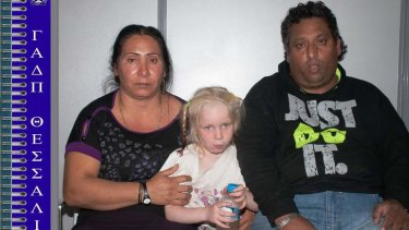 In this photo provided by the Hellenic Police, 40 year-old Selini Sali (or Eleftheria Dimolpoulou) and 39 year-old Christos Salis sit with a four-year-old girl reportedly named Maria, who was found living with the Roma couple in central Greece.