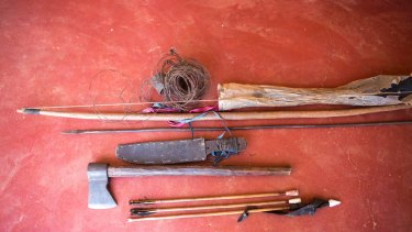 The poachers' tools include iron bars fashioned into spears, their tips dipped in poison.