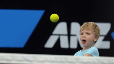 Peter Luczak's four-year-old son, Sebastian, helps his father warm up.