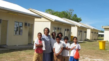 Principal Jocelyn Adam with students at Aiwo Primary School, formerly an Australian-built detention centre.
