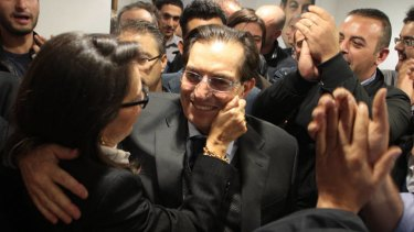 Champion of the south ... Rosario Crocetta is congratulated as the results of the election come in.