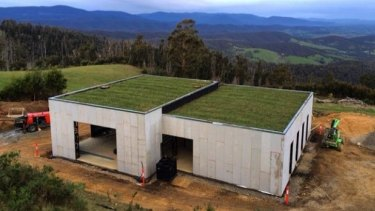 Green: The Bakker house features a grass roof, the soil of which helps insulate the building.