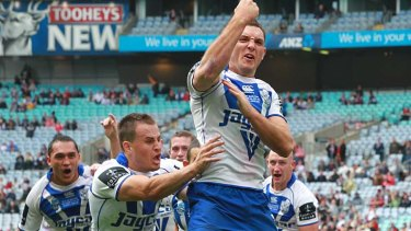 Jonathan Wright celebrates his miracle try for the Bulldogs.