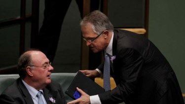 My point is ... Malcolm Turnbull has a  word with the opposition Whip Warren Entsch during question time in Canberra yesterday.