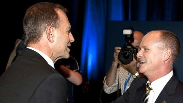 Federal Opposition leader Tony Abbott shakes hands with Campbell Newman at the LNP launch in Brisbane, March 4, 2012.