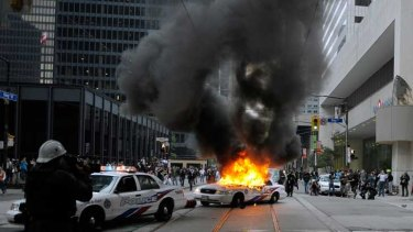 A police car burns on the streets of Toronto during G20 protests in June 2010.