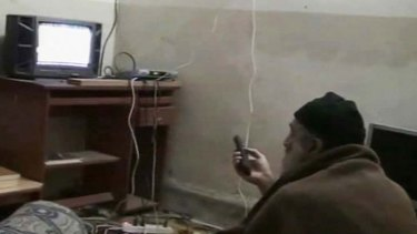 Osama bin Laden is shown watching himself on television in this video still released  by the Pentagon.