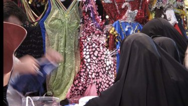 Being served ... A man sells women lingerie in Damascus.