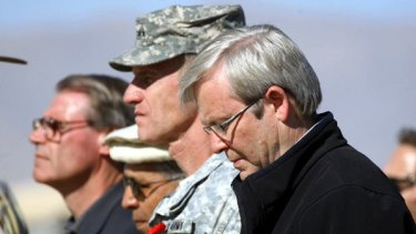 A minute's silence ... Kevin Rudd, the US General Stanley McChrystal, and the Defence Minister, John Faulkner, in Tarin Kowt.