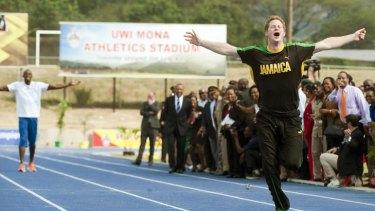 Winner ... Prince Harry leaves Usain Bolt for dead.