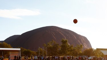 Children play in the shadow of Uluru in the Mutitjulu community.