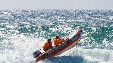 Lifesavers search off Kurrawa for teenager Matthew Barclay.