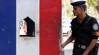 An Egyptian special force officer stands guard outside the French embassy in Cairo. France will close 20 diplomatic posts in Muslim countries on Friday.
