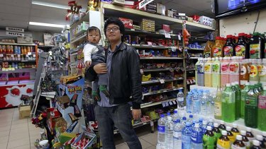 Non-stop: Michael Jiang with his son William.