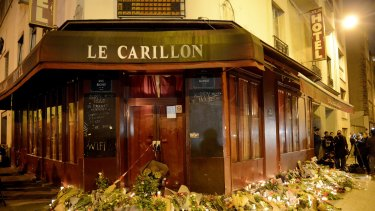 Flowers and candles are placed outside Le Carillon bar.