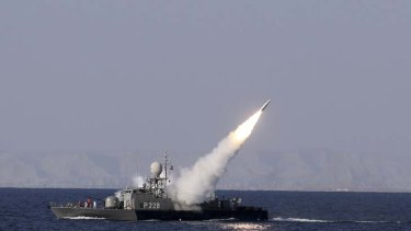 A new medium-range missile is fired from a naval ship during Velayat-90 war game on Sea of Oman near the Strait of Hormuz in southern Iran.