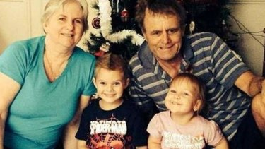 Missing: Catherine and Robert Lawton of Springfield Lakes with their grandchildren.
