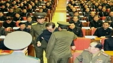 North Korean television released images that it said showed Jang Song-thaek being dragged from his chair by two police officials during a meeting in Pyongyang. North Korea.