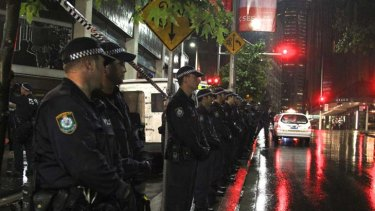 In full force ... NSW police outside the building on Clarence Street.