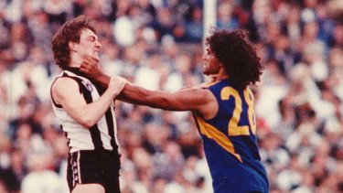 Key role: West Coast star Chris Lewis tangles with Collingwood's Mick McGuane.