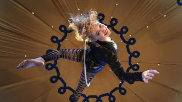 Performer Spenser Inwood of Circus Oz on the aerial ring.