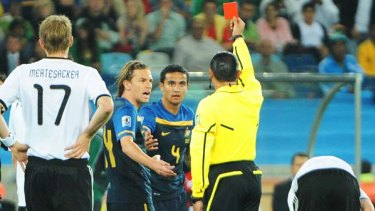Sent off ... Tim Cahill is shown a straight red card following a tackle on Bastian Schweinsteiger.