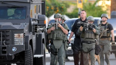Authorities search for a gunman believed to be on the run after the San Bernardino shooting.
