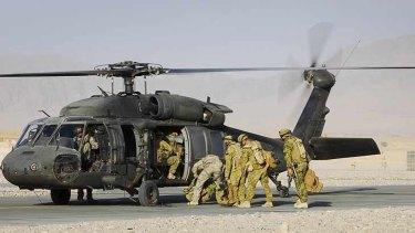 Black Hawk ... Australian soldiers boarding the US chopper in Afghanistan in 2009.
