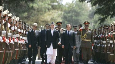Unwavering: Afghan President Hamid Karzai (left) and French President Nicolas Sarkozy walk through a guard of honour in Kabul yesterday. PICTURE: AP