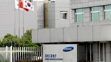 The Chinese and South Korea flags fly outside a Samsung facility in Suzhou on September 5, 2012.