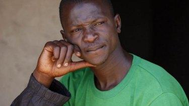 Looking for another wife: Mahammadu Saidu, the former husband of Maimuna Abdullahi, sits outside his home in Kaduna, Nigeria.