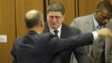 Cleveland police officer Michael Brelo hugs his attorney, Patrick D'Angelo after being found not guilty.