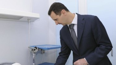 Syria's President Bashar al-Assad, during his visit to troops wounded in clashes with rebels.