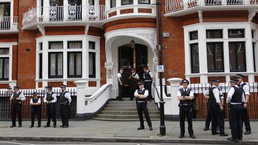 British police officers stand guard outside the Ecuadorian Embassy in central London after after Ecuador announced it had granted political asylum to WikiLeaks founder Julian Assange.