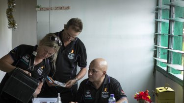 Clinical co-ordinator Jo Bergman, logistic staff member Peter Maddern and project manager Stewart Kreltszheim set up a clinic in Buna village.