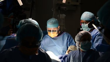 Dr Glenn Gardener performs groundbreaking in-utero surgery on a baby with spina bifida.