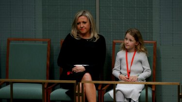 Mrs Bishop's family listen to her valedictory in the House of Representatives on Wednesday.